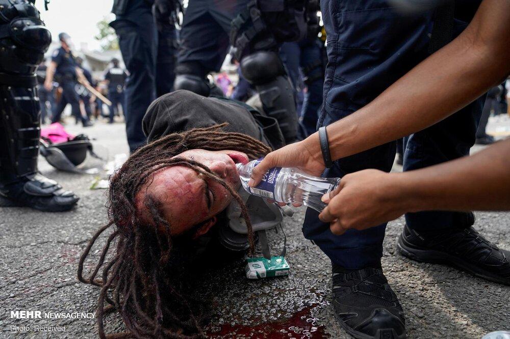 عکس/ روشن شدن آتش اعتراضات آمریکا در پی تبرئه افسران قاتل دختر دانشجو