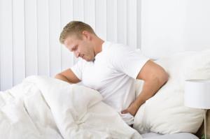 چرا گاهی اوقات کووید 19 میتواند باعث کمردرد شود؟