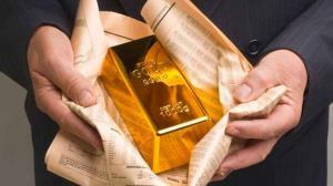 قیمت جهانی طلا بیش از 15 دلار کاهش یافت