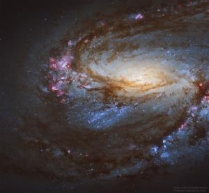 کهکشان مارپیچی M66 از نگاه هابل
