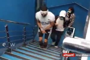 بالا رفتن از پلههای برج میلاد با دست و پای بسته به یاد شهدای غواص