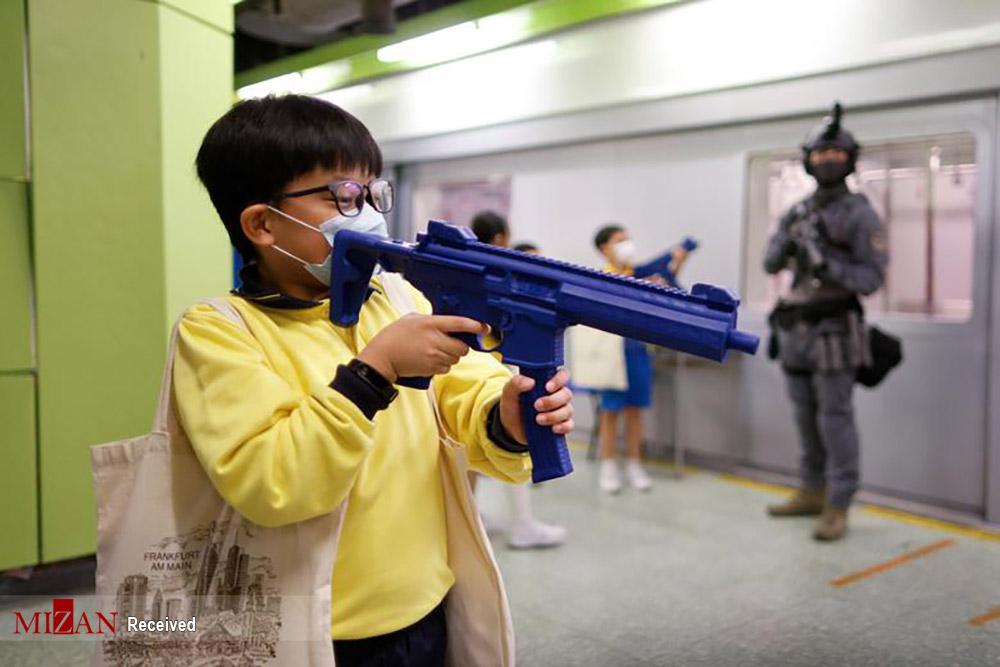 روز امنیت ملی با تفنگ پلاستیکی
