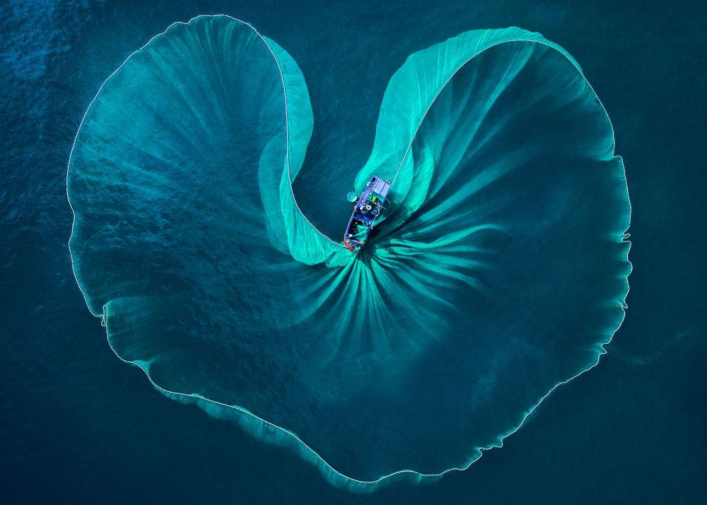 تصویری رمانتیک از تور انداختن ماهیگیر
