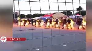 قدم زدن بدلکاران حرفه ای با تنی غرق در آتش شعله ور