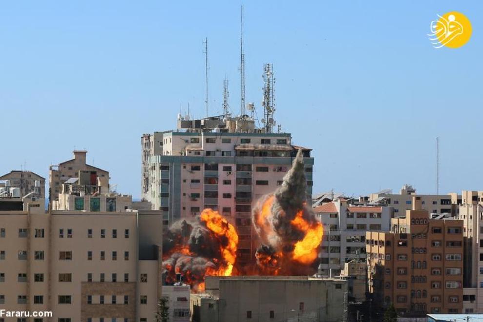 عکس/ انهدام برج محل استقرار الجزیره و آسوشیتدپرس در غزه