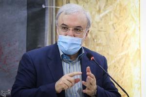 تصویر وزیر بهداشت در هنگام رای دادن