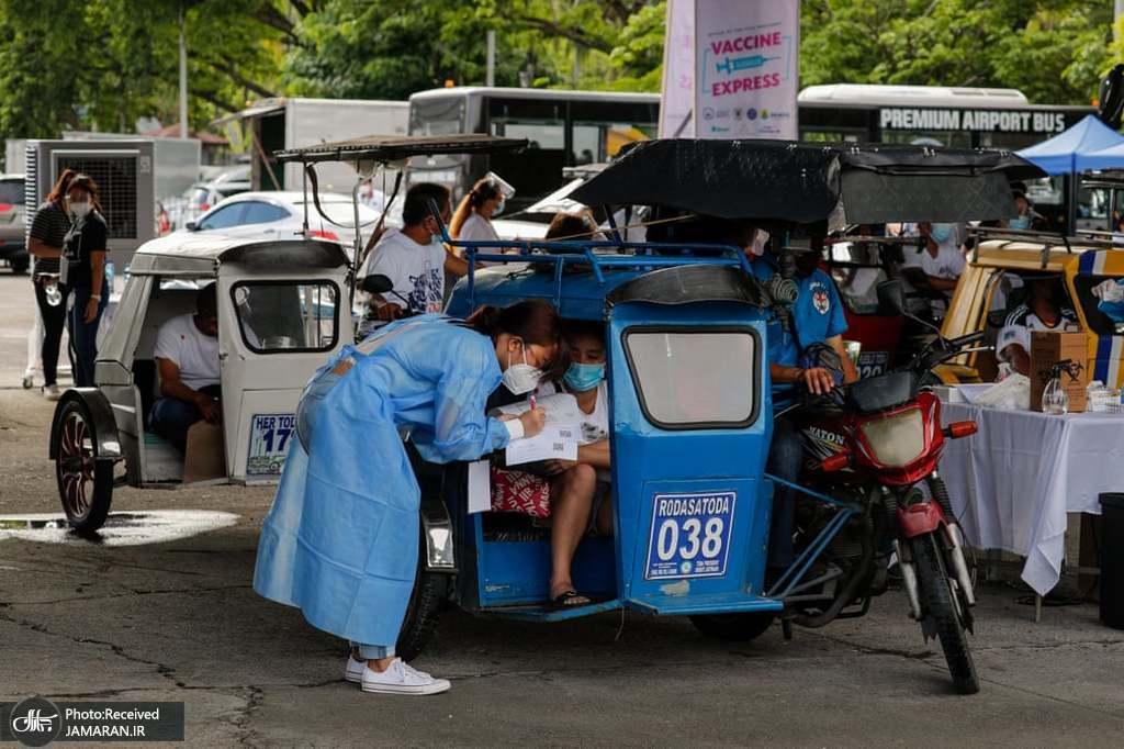 واکسیناسیون علیه کرونا داخل محوطه پارکینگی در فیلیپین