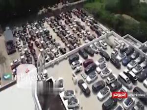 تصاویر هوایی از خودروهای لاکچری آسیب دیده در نمایشگاه چین پس از وقوع سیل
