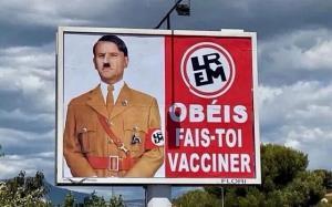 ماکرون با چهره هیتلر روی بیلبورد تبلیغاتی
