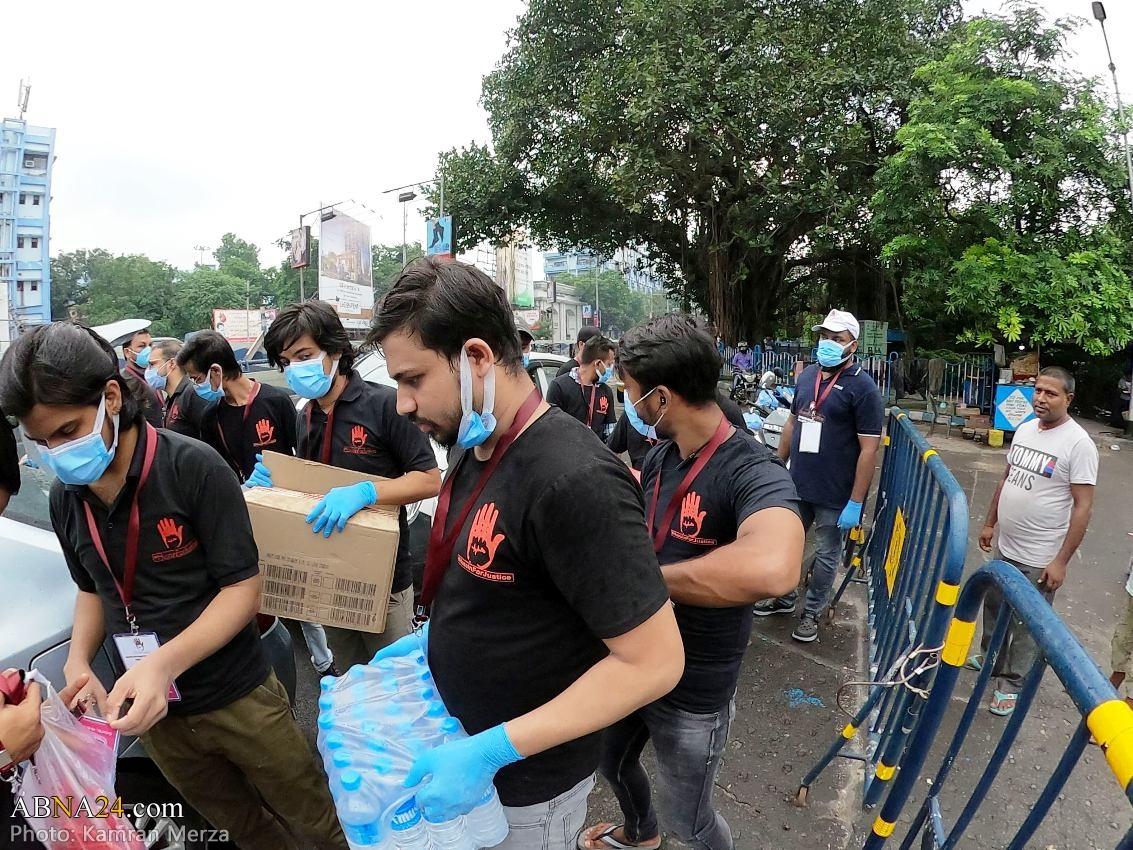 عکس/ توزیع آب توسط کمپین