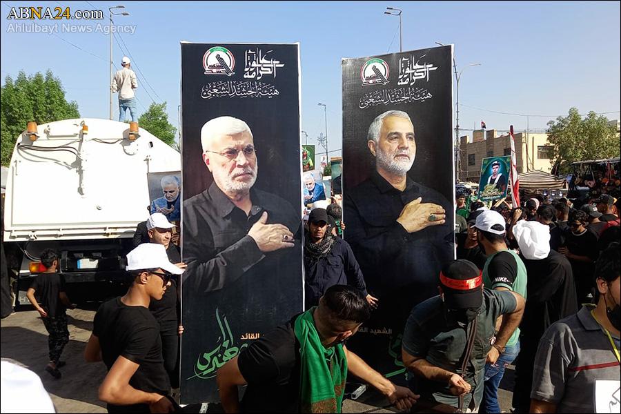 تصاویری از شهیدان سردار سلیمانی و ابومهدی المهندس در دست زائرین اربعین