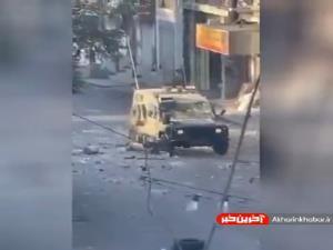 سنگ باران خودرو نظامی نیروهای اشغالگر قدس توسط جوانان فلسطینی