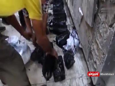 200 کیسه اسکناس از زیر آوار شعبه بانک مرکزی عراق خارج شد