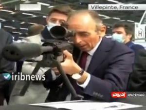 رقیب مکرون، خبرنگاران را با تفنگ نشانه گرفت!