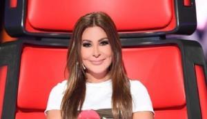 خواننده زن عرب با جلیقه ضدگلوله روی سن رفت