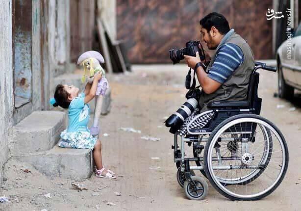 عکس/ پشتکار یک عکاس بدون پا