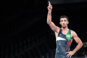 قهرمان کشتی جهان و المپیک خادم امام رضا(ع) شد