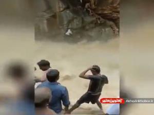 نجات معجزه آسای دو مرد سقوط کرده در جریان تند آب